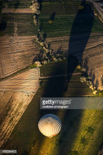 Morning balloon over the field in aerial view