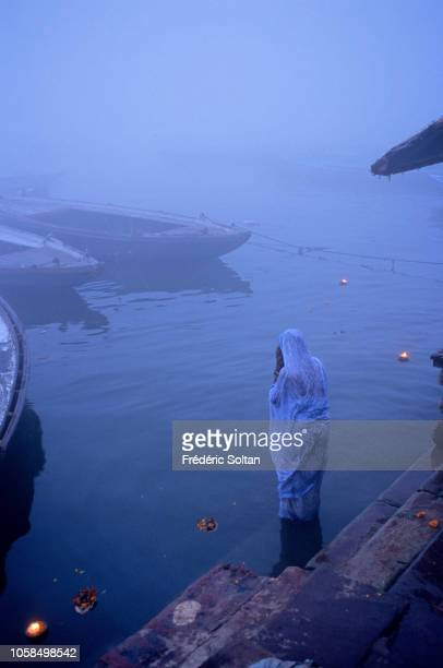Morning bath in the Ganges in Holy City of Varanasi Religious capital of Hinduism Varanasi is closely associated with the Ganges River and is one of...