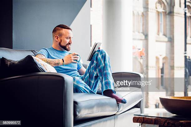 morning catch up on the news - pajamas stock pictures, royalty-free photos & images