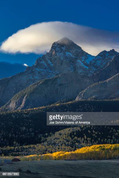 Morning Clouds at sunrise over San Juan Mountains In Autumn near Ridgway Colorado off Hastings Mesa dirt road to Telluride CO