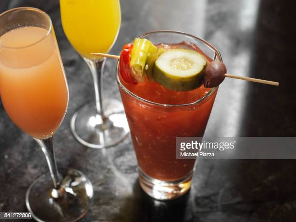 morning cocktails on the bar: bloody mary, mimosa - mimosa stock pictures, royalty-free photos & images