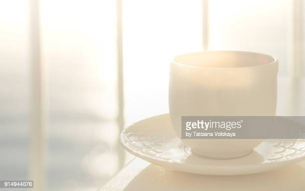 Morning coffee cup in the sunlight