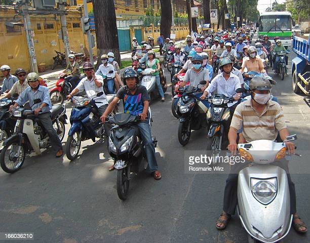 CONTENT] Morning commute of thousands of scooters swarming Ho Chi Minh City