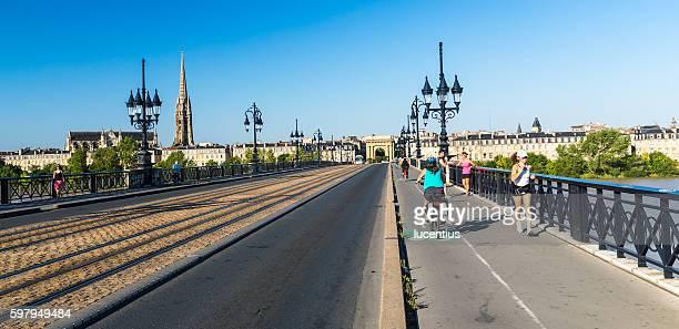 morning commute, pont de pierre, bordeaux - gironde stock pictures, royalty-free photos & images