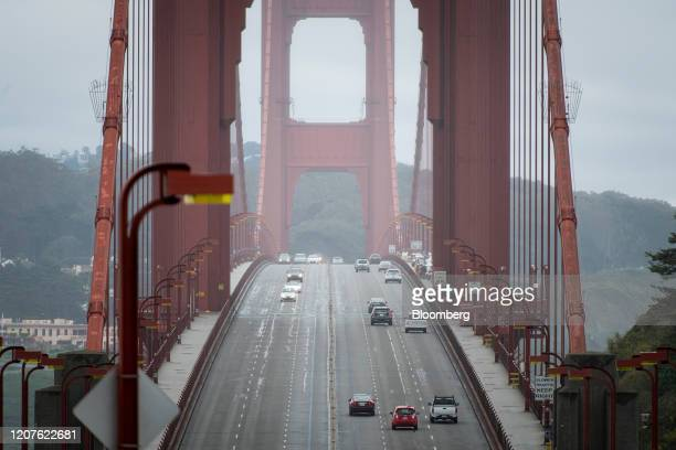 Morning commute traffic drives over the Golden Gate Bridge in San Francisco, California, U.S., on Wednesday, March 18, 2020. Six of the biggest...