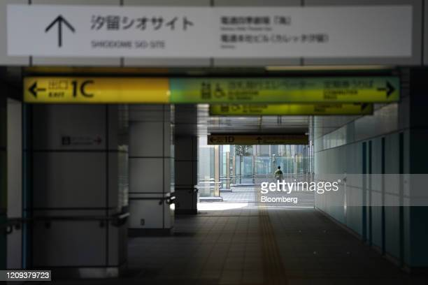 Morning commuter walks in the Shiodome business area in Tokyo, Japan, on April 8, 2020. Prime MinisterShinzo Abewarned Japan could be facing as...