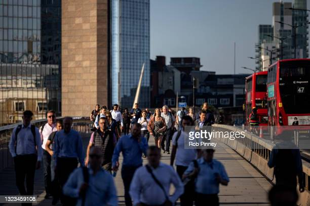 Morning commuters cross London Bridge on June 14, 2021 in London, England. Under the current timeline, all Covid-19-era restrictions could end June...