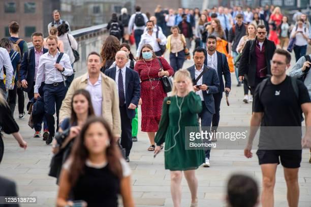 Morning commuters cross London Bridge towards the City of London, U.K., on Thursday, Sept. 9, 2021. While London's underground rail system ridership...