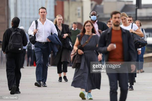 Morning commuters cross London Bridge towards the City of London, U.K., on Monday, Sept. 13, 2021. The ending of the government's furlough scheme in...