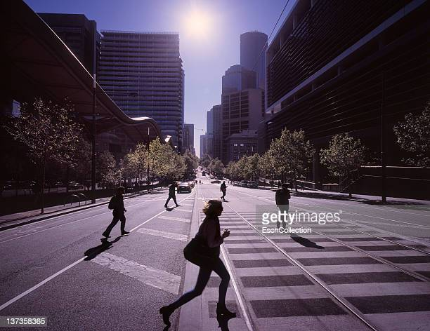 Morning commuters crossing the street in Melbourne