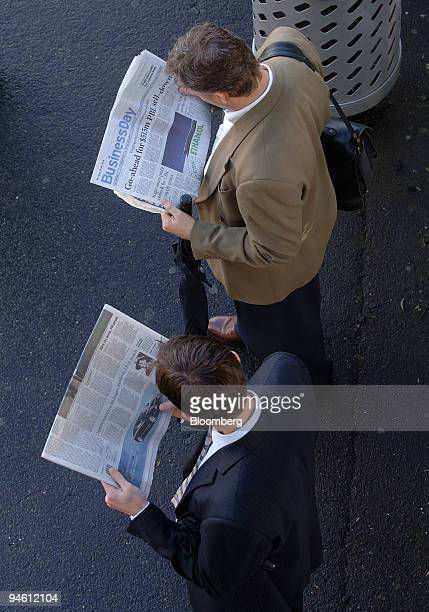 Morning commuters read the newspaper while waiting for a train in Sydney Australia on Wednesday Sept 5 2007 Australian consumer confidence rose in...