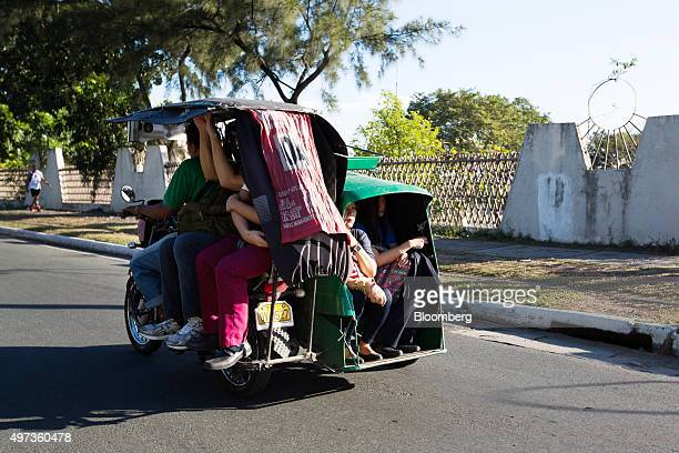 Morning commuters ride a tricycle in Taguig City Manila the Philippines on Monday Nov 16 2015 Economic growth in Asia Pacific will likely accelerate...