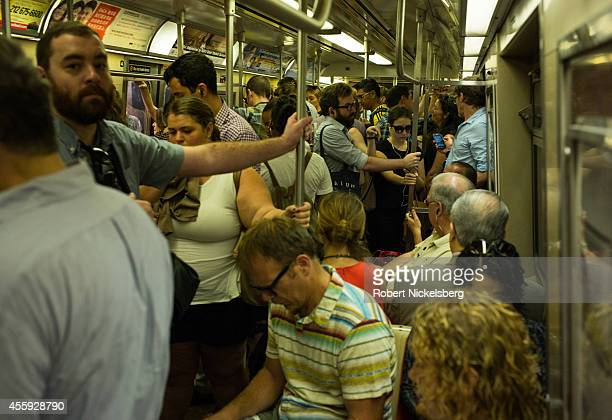 Morning commuters ride the subway September 5 2014 in the Brooklyn borough of New York