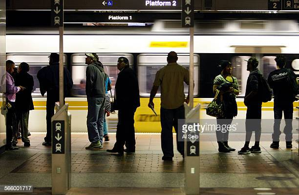 Morning commuters stand past the standalone TAP validators at the transfer point of the Los Angeles County Metro Rail 7th Street/Metro Center located...