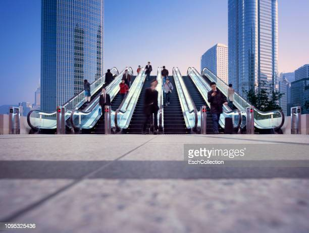 Morning commuters using a six lane escalator to get to their destination
