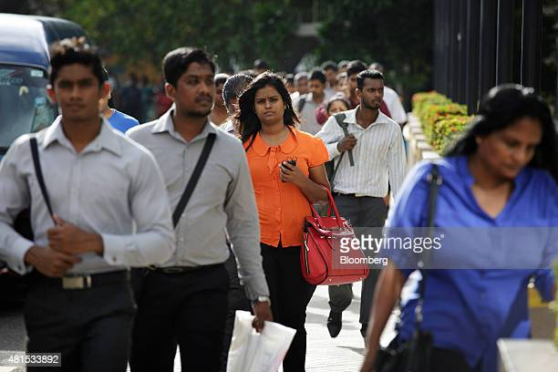 Morning commuters walk outside the Colombo World Trade Center in the central business district of Colombo Sri Lanka on Tuesday July 22 2015 The South...