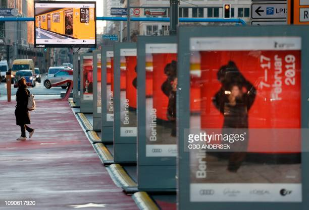 Morning commuters walk past posters announcing the upcoming Berlinale film festival along Potsdamer Strasse in Berlin on Januery 28 2019 The 69th...