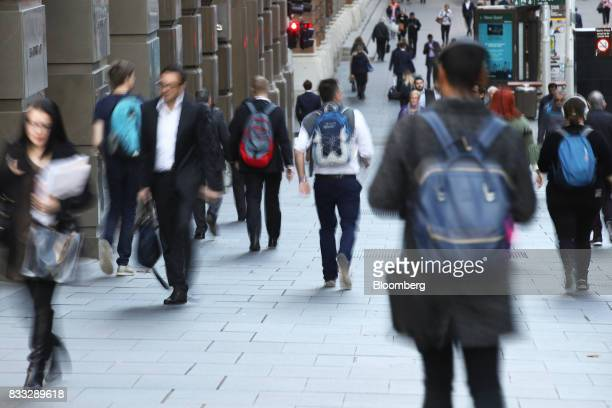 Morning commuters walk through Martin Place in Sydney Australia on Thursday Aug 17 2017 Australian employers added more jobs than forecast in July...