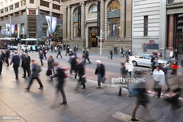 Morning commuters walk through Martin Place in the central business district in Sydney Australia on Thursday Aug 13 2015 Australian business...