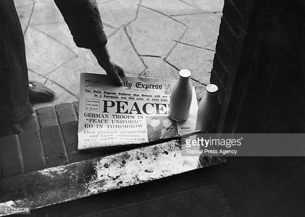 A morning copy of the Daily Express reassures the public that Britain will not be going to war 30th September 1938 The picture beneath shows British...