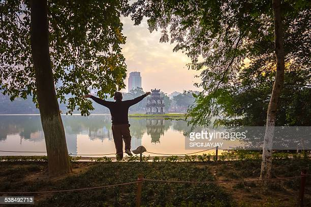 Morning Exercise at Hoan Kiem Lake of Hanoi