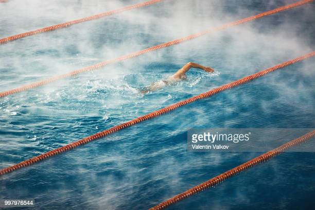 morning fog at swimming pool - length stock photos and pictures