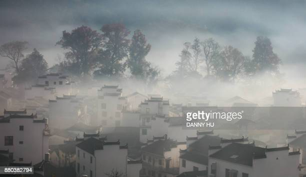 Morning fog covering Shicheng village in Wuyuan, Anhui province,China