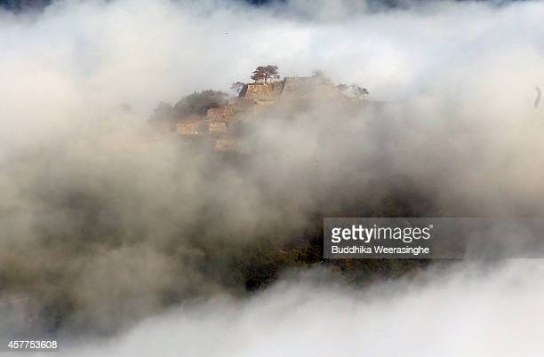Morning fog covers the Takeda castle seen from Ritsuunkiou Mountain on October 24 2014 in Asago Japan The Takeda castle is one of the most beautiful...