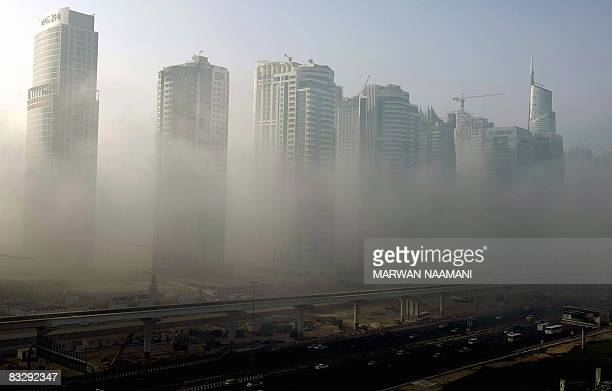 Morning fog engulfs Sheikh Zayed road in Dubai on October 16 2008 Fog in the UAE drops sometimes visibility to almost zero causing massive car...