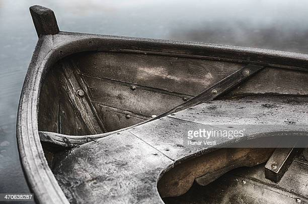 Morning frost on a rowboat in wood