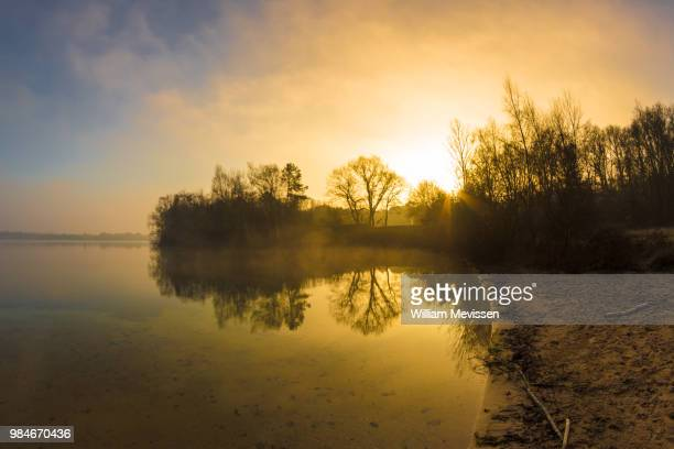 morning glow 'bay' - william mevissen stock pictures, royalty-free photos & images