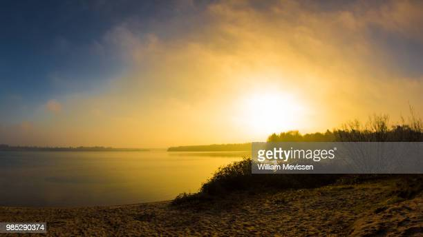 morning glow 'lake' - william mevissen stock pictures, royalty-free photos & images