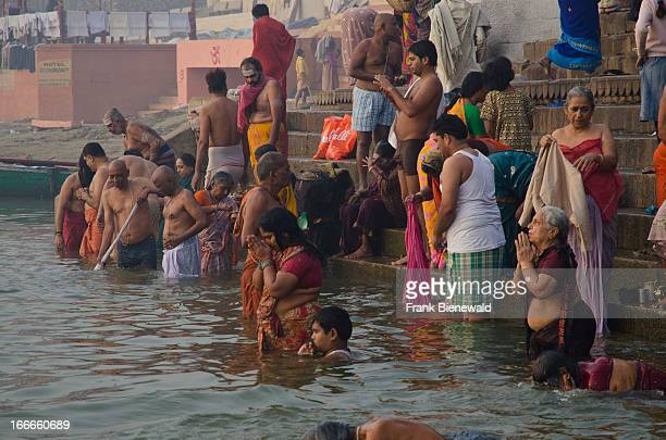 Morning hours are busy with pilgrims at the ghats of Varanasi