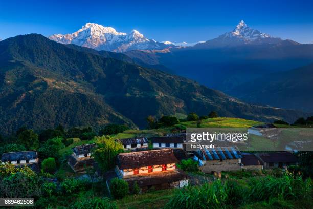 morning in gurung village, annapurna and machhapuchhare on background - machapuchare stock photos and pictures
