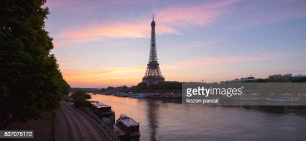 Morning in Seine river in Paris with Eiffel tower ( France )