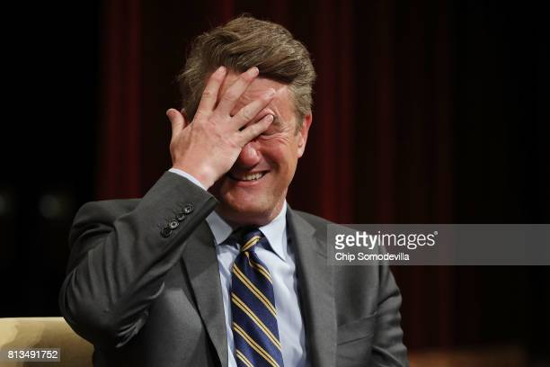 MSNBC 'Morning Joe' host Joe Scarborough reacts during an interview with his cohost Mika Brzezinski and philanthropist and financier David Rubenstein...