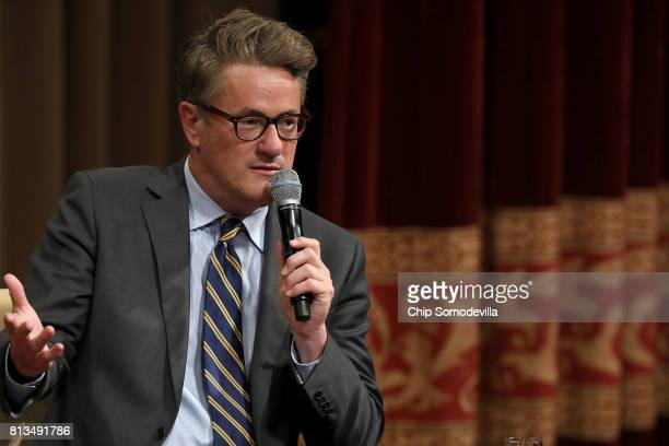 MSNBC 'Morning Joe' host Joe Scarborough speaks during an interview with his cohost Mika Brzezinski and philanthropist and financier David Rubenstein...