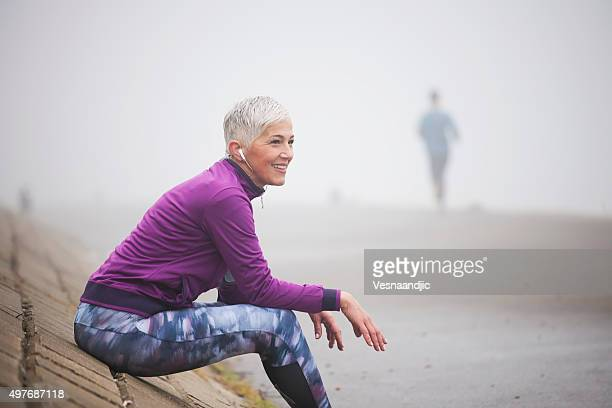 morning jogging - one mature woman only stock pictures, royalty-free photos & images