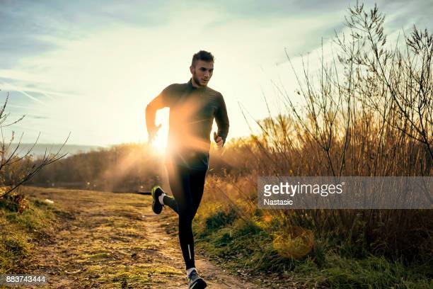 morning jogging - cross country running stock pictures, royalty-free photos & images