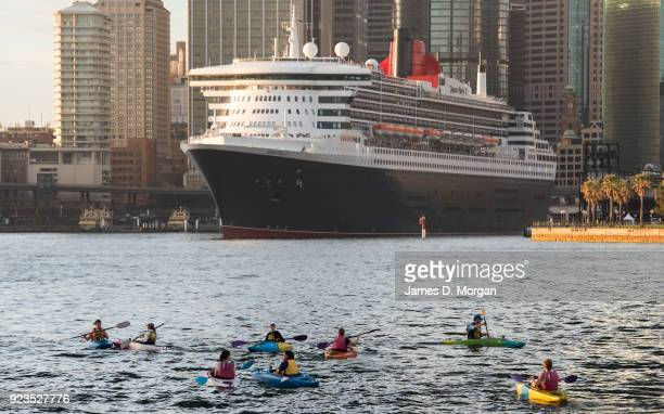 Morning kyakers watch as the Cunard ocean liner Queen Mary 2 arrives into Sydney Harbour on her world cruise from Southampton, England on February...