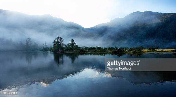 morning light  and mist across sound and mountains - british columbia stock pictures, royalty-free photos & images