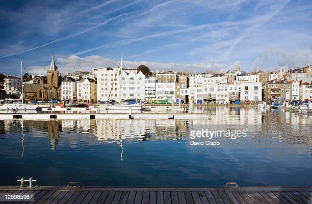 morning light at the harbour at st peter port, guernsey, channel islands, england - isola di guernsey foto e immagini stock