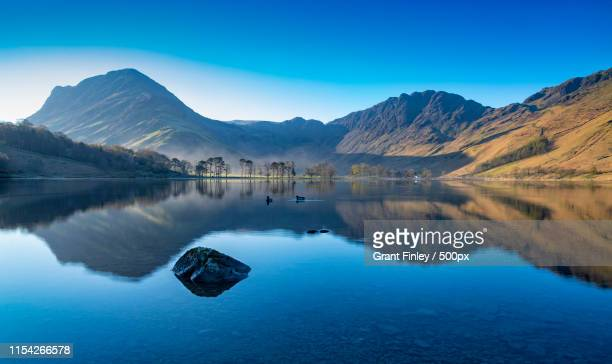 morning light at the lake - keswick stock photos and pictures