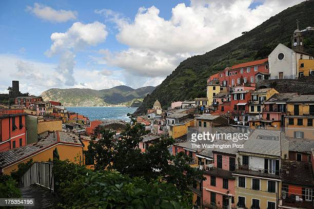 Morning light illuminates colorfully painted buildings on Sunday May 19 2013 in Vernazza Italy The area experienced significant damage from a 2011...