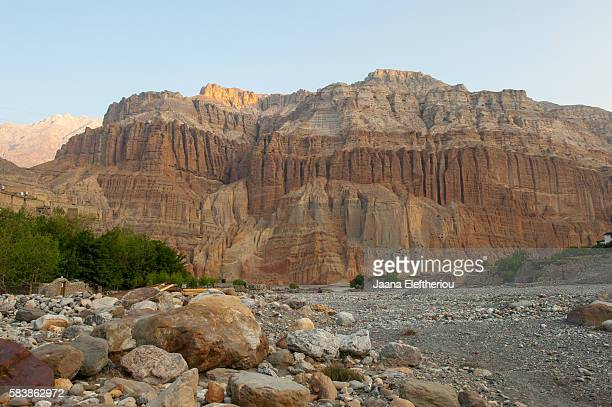 morning light on the red cliffs in  upper mustang region nepal