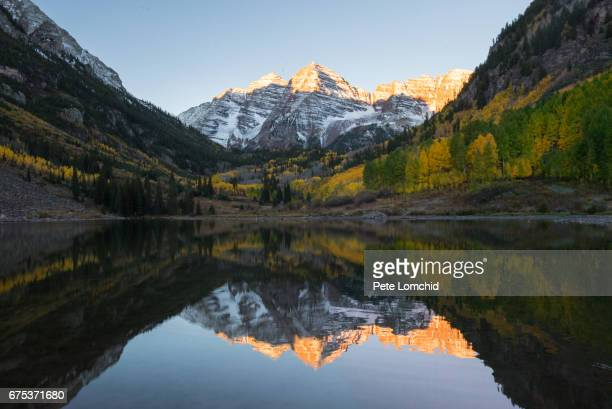 morning maroon bell colorado - maroon bells stock photos and pictures