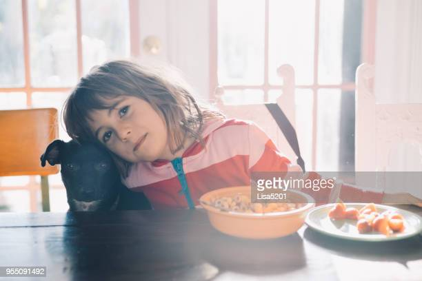 morning meal - dog eats out girl stock pictures, royalty-free photos & images
