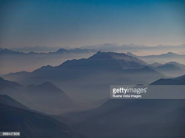 Morning mist in a valley among mountains