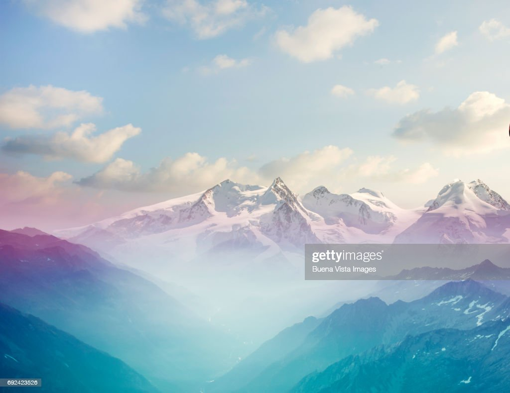 Morning mist in an alpine valley : Stock Photo