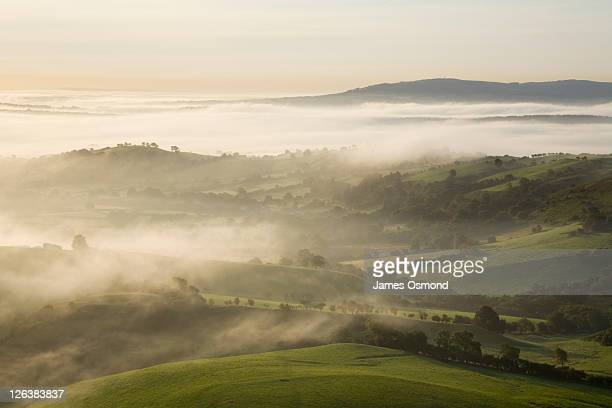 Morning mist over rural Shropshire with the Clee Hills in the Distance, Shropshire, England, UK